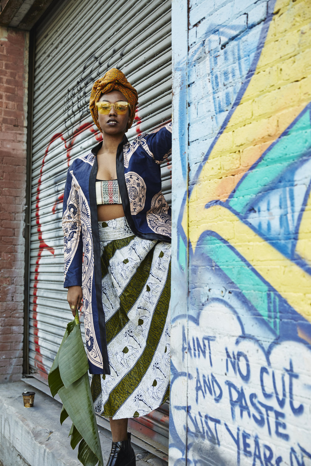 Dominique Drakeford wearing jacket by Mwayi