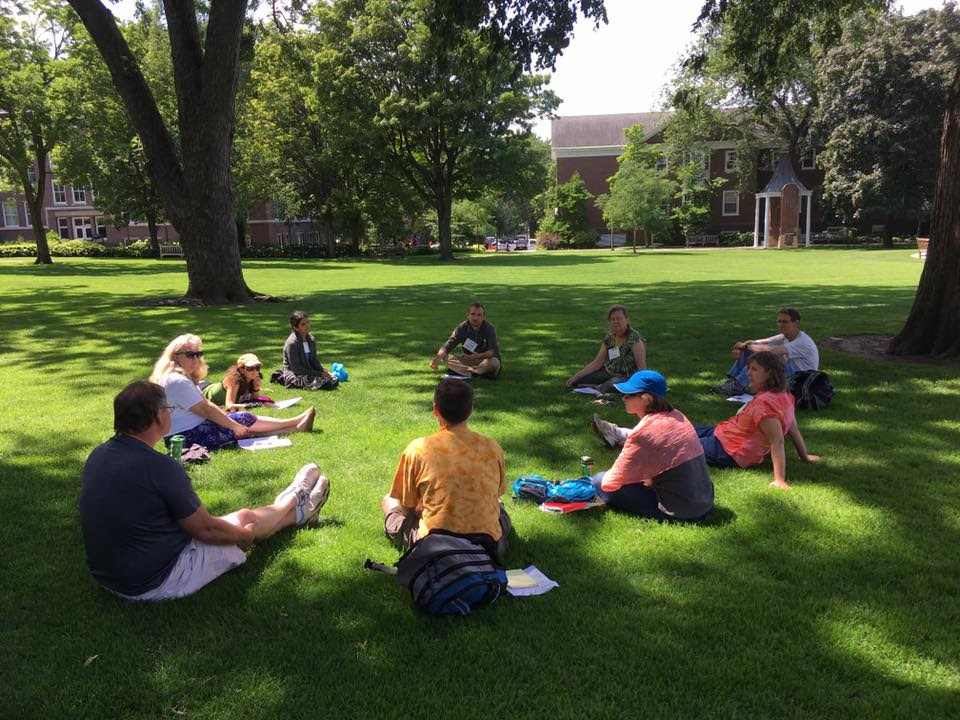 Don Hall's Effective Collaboration training group takes class outside onto the macalester college Quad. Photo by Nils palsson.
