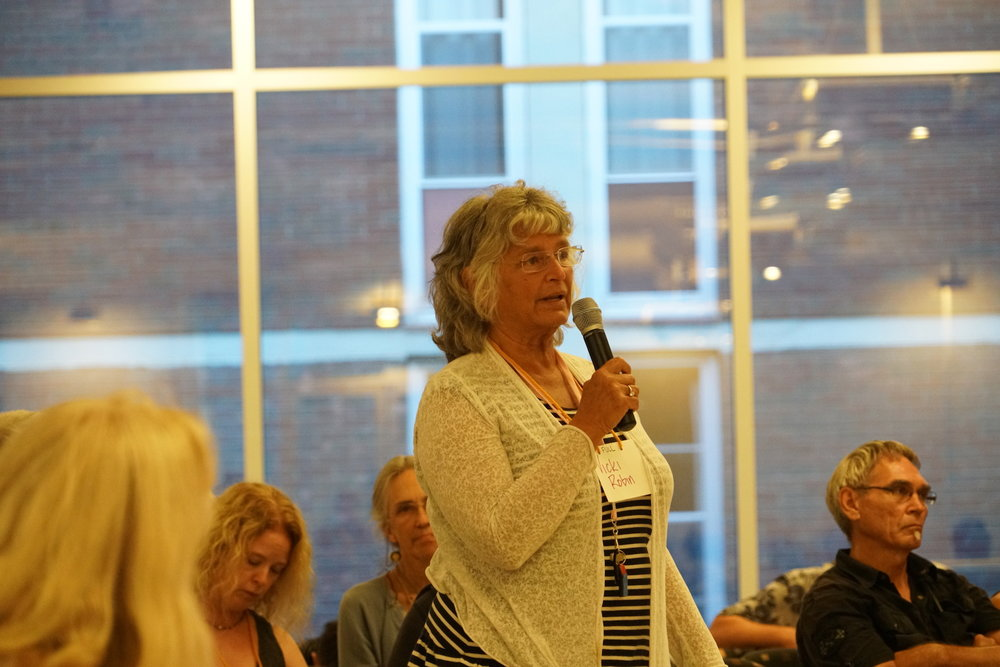 Transition superstar Vicki Robin asks a question of keynote speaker Richard Heinberg during the Q&A portion of his presentation. Photo by Teresa Konechne.