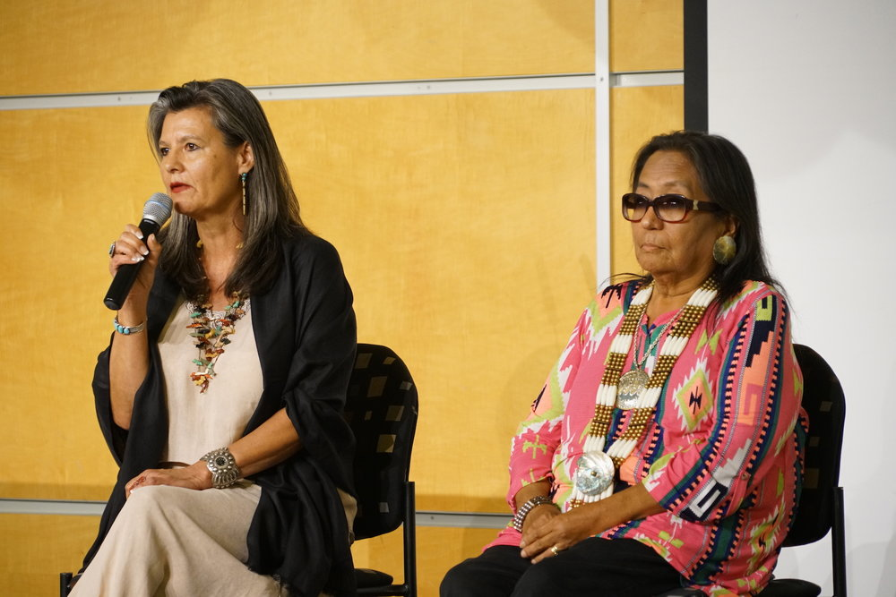 Two of the leading women of Standing Rock, Phyllis Young and Pearl Means, share the stage during Saturday night's keynote address. Photo by Teresa Konechne.