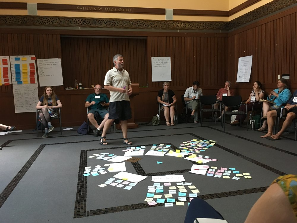 "Economic relocalizers hard at work designing the future during a two-day intensive on ""Skilling Up for Local Economic Resilience."" Photo by Teresa Konechne."