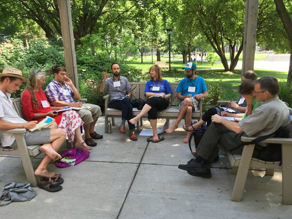 "Adam Brock takes his class outside to enjoy the beautiful Minnesota summer during a one-day intensive on ""Social Permaculture Strategies for Transition."" Photo by Nils Palsson."