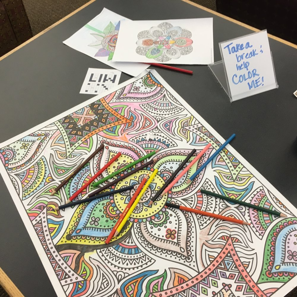 Somebody wisely realized that everybody needs a break sometime from the hard work of changing the world, and brought mandalas for everyone to color! Photo by Nils Palsson.