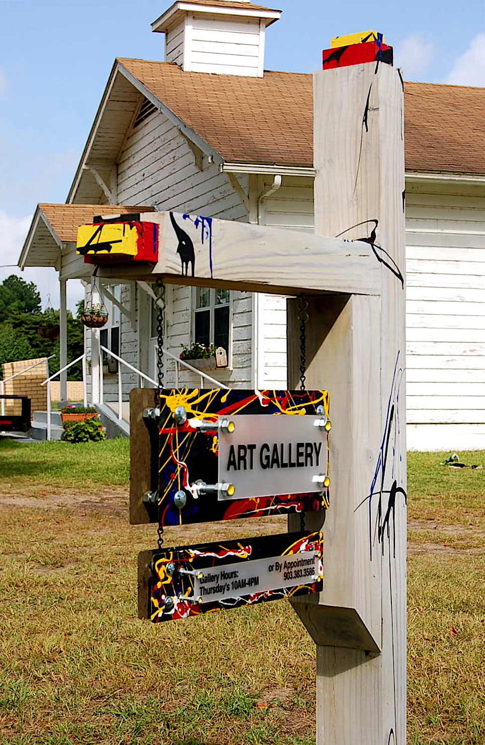 "The signpost speaks - ""..there is art here..."""