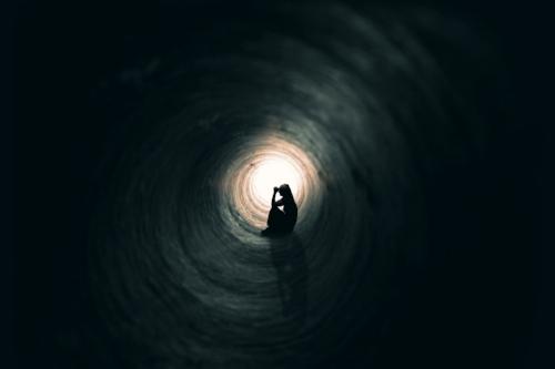 girl in a dark tunnel