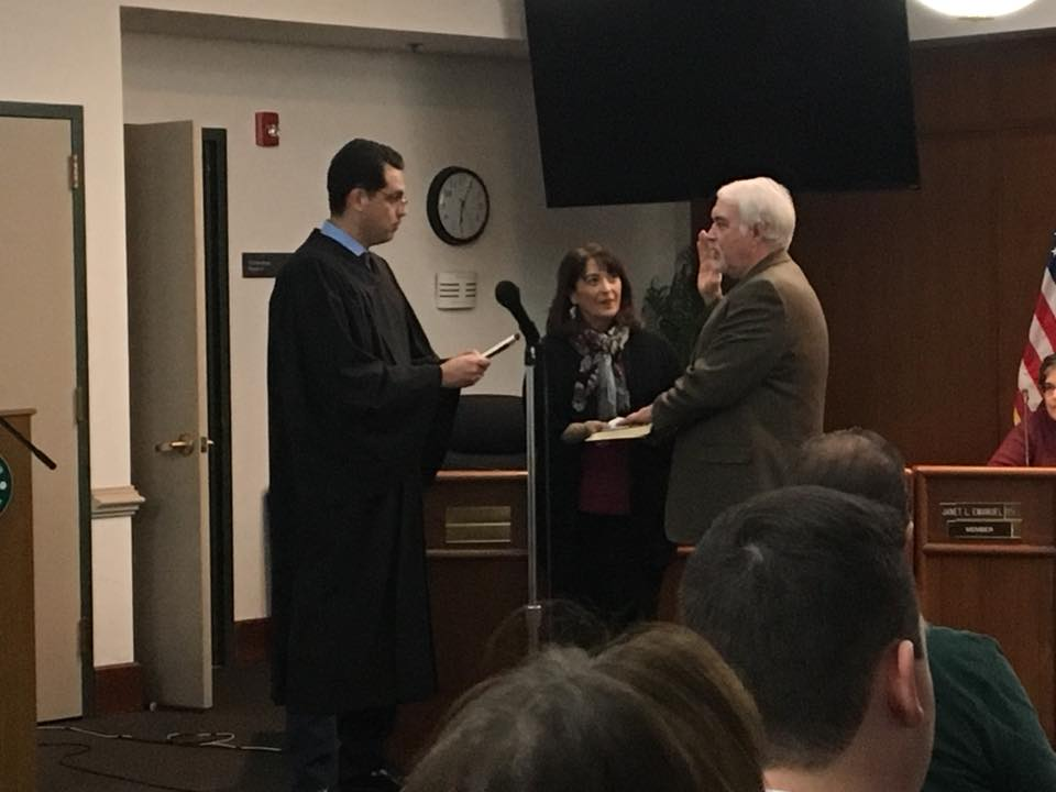 David Shuey being sworn in by Judge Tom Tartaglio.