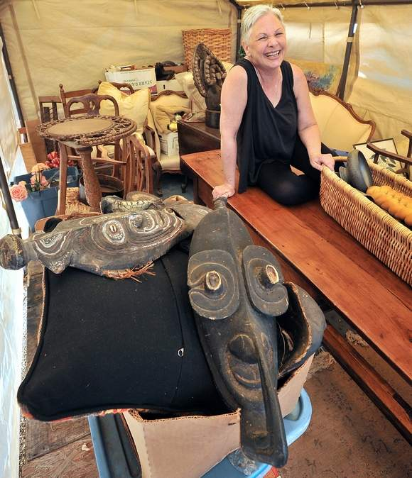 "Bobbie Saria, photographed in one of the cottages on her property in Ashland, plans to sell her home after an estate sale of the belongings she and her late husband collected as ""stagers"" ― people who decorate homes for real estate showings. Jamie Lusch/Mail Tribune"