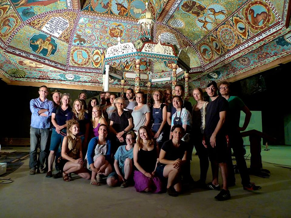 Group photo of artists in front of the completed bima and ceiling, The Museum of the History of Polish Jews, Warsaw, Poland, 2013