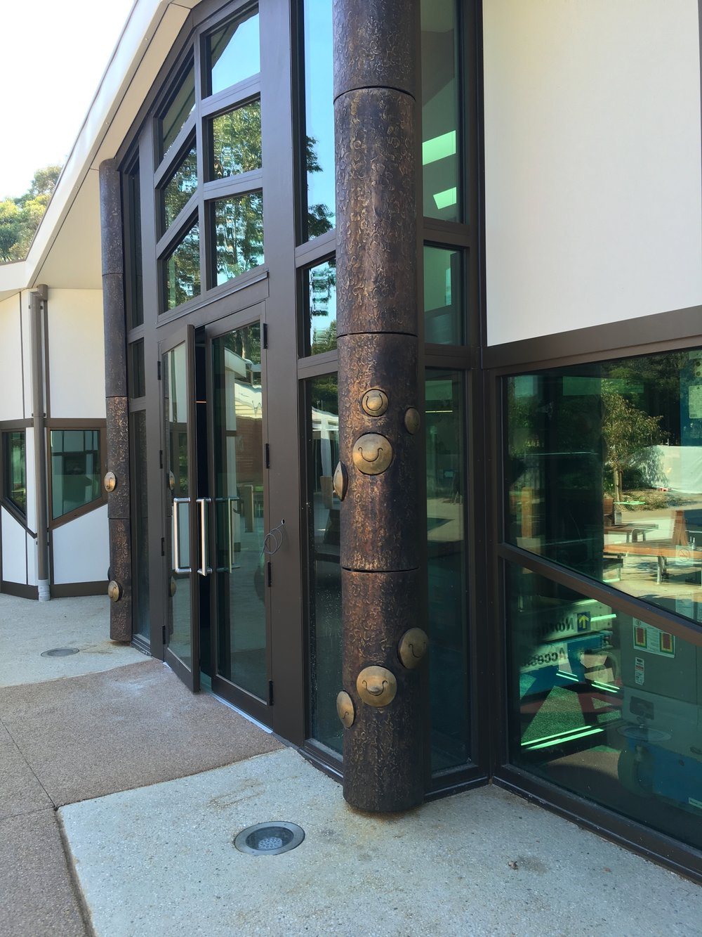 Montrose Sound Columns, Montrose Library, 2017. Playable bronze  tongue drums set into the two bronze columns as part of the ArchitectureMatters Project Design.