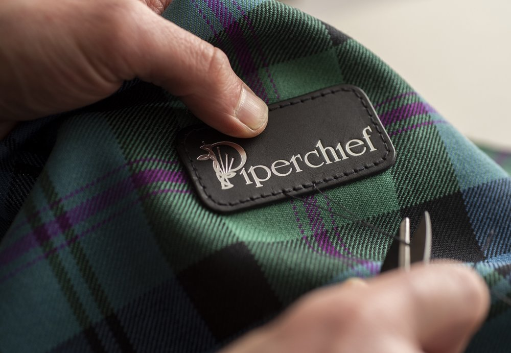 Personal Touch  - And finally, we use the best Lochcarron Woven Tartan and leather stamping to give each bag an individual, Scottish twist that can also be customised to you or your team.