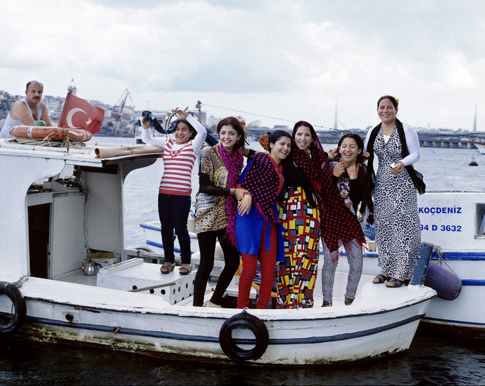 We heard music first and then saw a boat in the middle of the Golden Horn with seven figures on it - all dancing and singing.  It was an amazing sight. So full of joy. I just hoped they were coming to shore sometime soon near me.