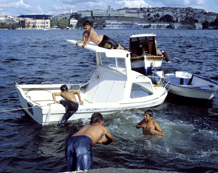 Boys enjoying a swim in the Golden Horn.Istanbul 2013.