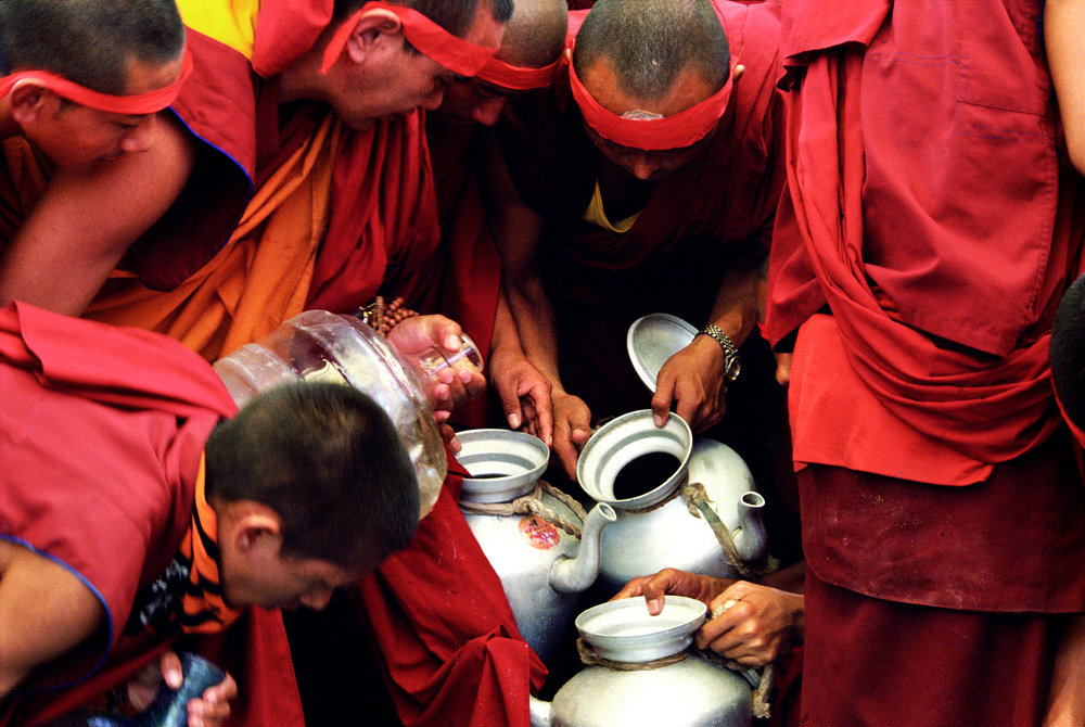 Web_amar_Tea monks filling blessed water ino their pots.jpg