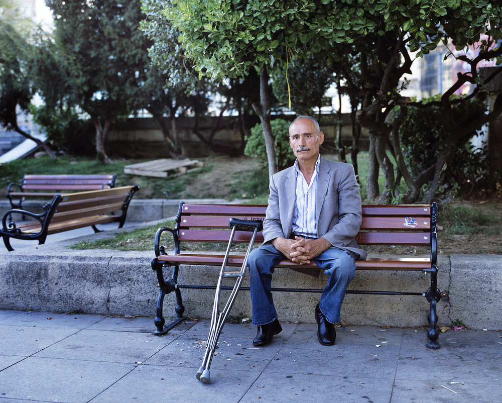 GeziPark _Istanbul_12GeziPark Gentle Resistance011Man with crouch_Claudia_Leisinger_2_copyright Claudia Leisinger_copyright Claudia Leisinger.jpg