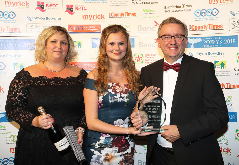 PCI Pharma Services' training supervisor Tracey Lewis and account manager Paige Morgan receive the Powys Business of the Year Award from David Powell, of Powys County Council, sponsor.
