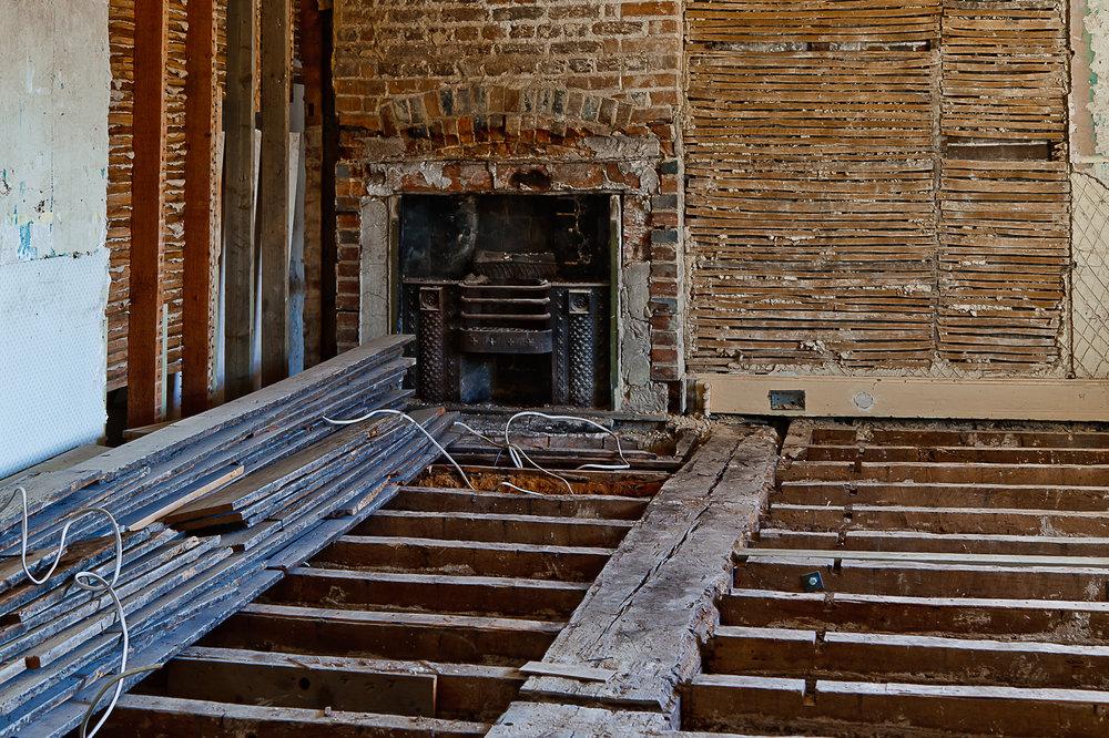 Glynde Place - Phase I - Bedroom fireplace exposure (Carlotta Luke).jpg