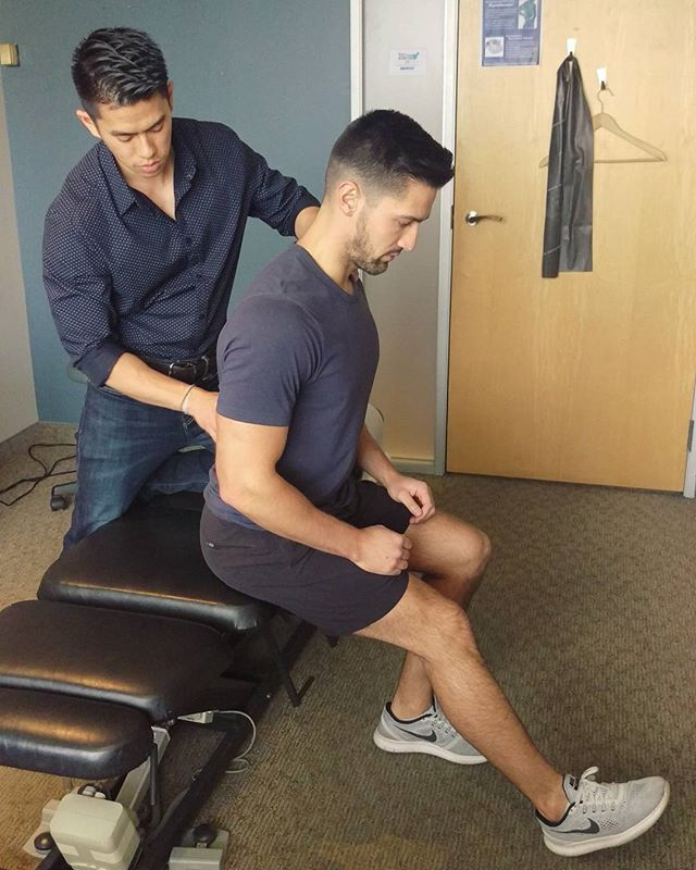 Hamstring Stretch in Sitting: sit at the edge of your chair holding a very upright posture with pelvis rotate forward to give a slight arch in the lower back. With a slight bend in your knee, hinge forward from the hip until you feel the stretch in the back of your thigh. Hold 30sec each side.  Tight hamstrings largely contribute to low back pain, knee pain, and poor postures while sitting, squatting, and playing sport. Tension in the 3 large muscles of the hamstrings will cause the pelvis to rotate backward and limit the knee from fully straightening. A very important stretch for desk jobs, runners, or people experiencing issues and rounding with squats or deadlift exercises.  #hamstrings #stretching #squats #deadlifts #backpain #exercise #fitness #health #rehab #Toronto #fitfam #physio #chiro #massage #muscles #tight #release #healthy #flexible #workout #training #posture #stretch #relax