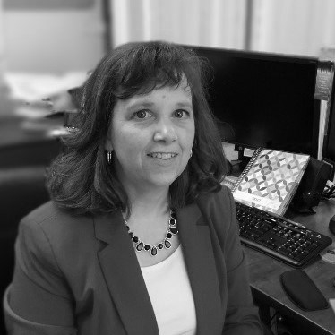 Gail at desk BW.jpg