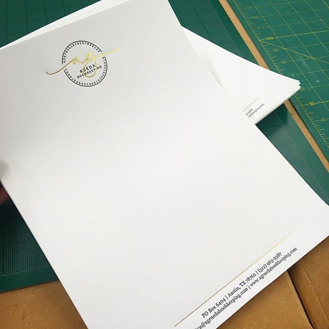 Letterpress and foil stamped letterheads for matching business cards on Classic Crest Solar White with stipple finish.