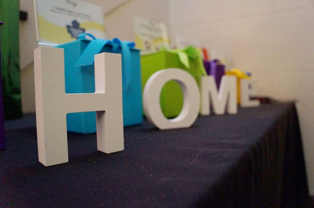 "Colourful raffle table display with ""home"" marquee letters - Historia Wedding and Event Planning"