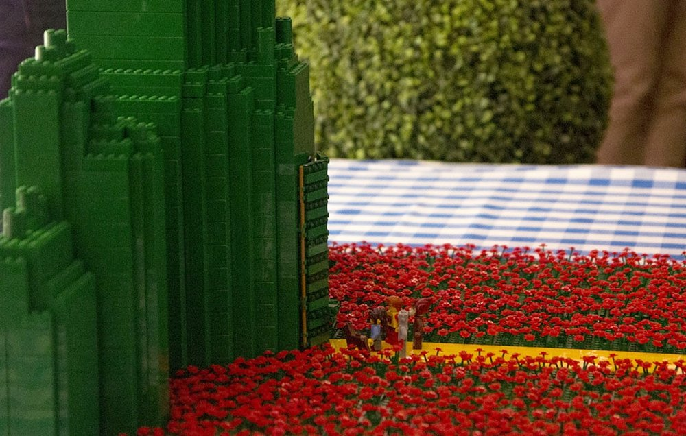 Sideways closeup of Emerald City lego display with Wizard of Oz characters by BrickManGraeme - Historia Wedding and Event Planning
