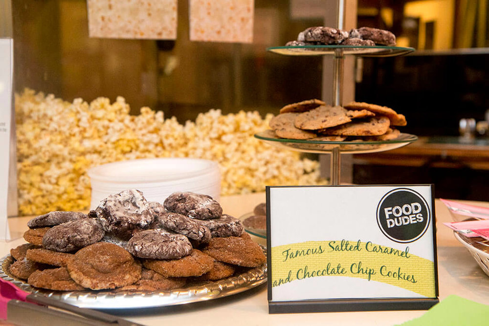Closeup of salted caramel and chocolate chip cookies sponsored by Food Dudes - Historia Wedding and Event Planning