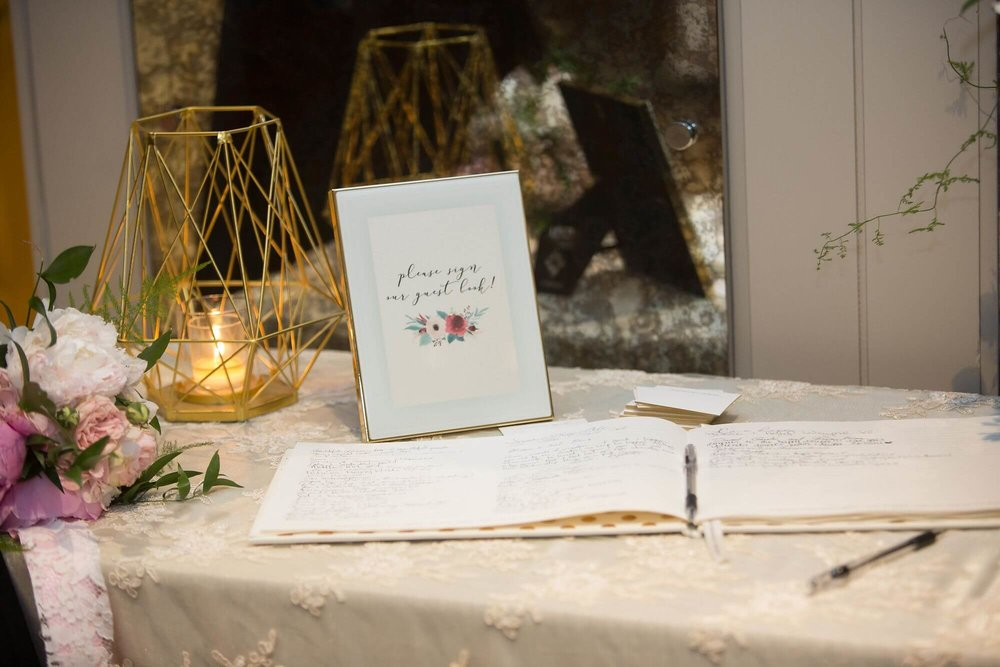 Guestbook with framed sign and geometric gold candle holder - Champagne, Blush and Gold Niagara Wedding - Historia Wedding and Event Planning