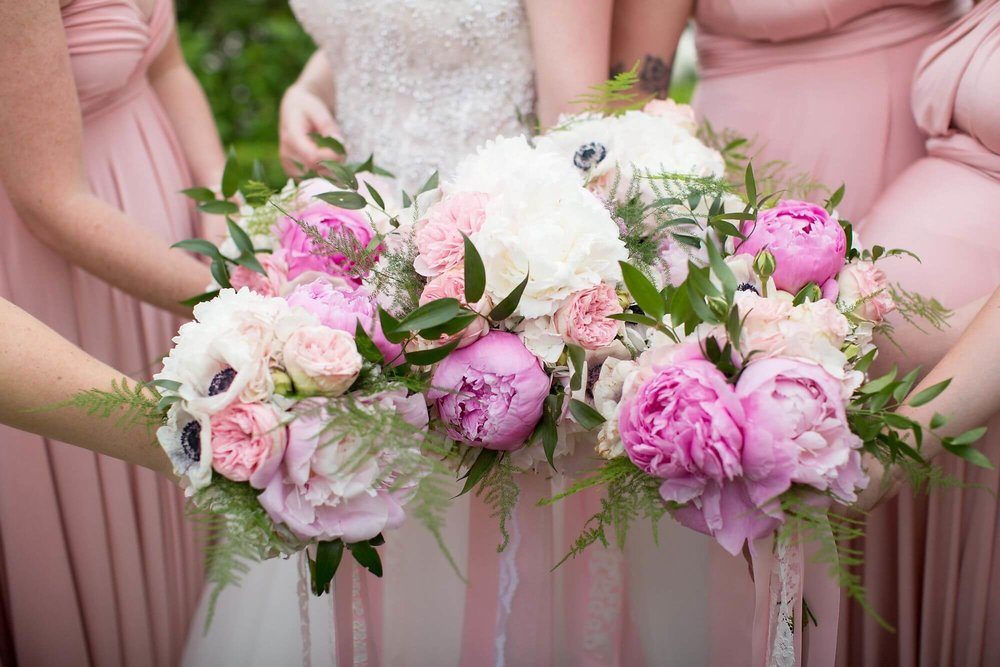 Closeup of bridal party bouquets being held together by bride and her bridesmaids - Niagara wedding - Historia Wedding and Event Planning