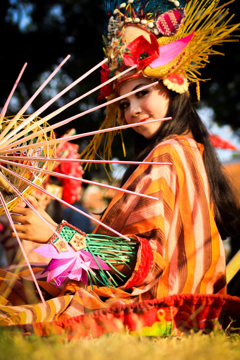 Cultural dancers or performers in colourful costumes like this one can and should be considered an element of your event decor.