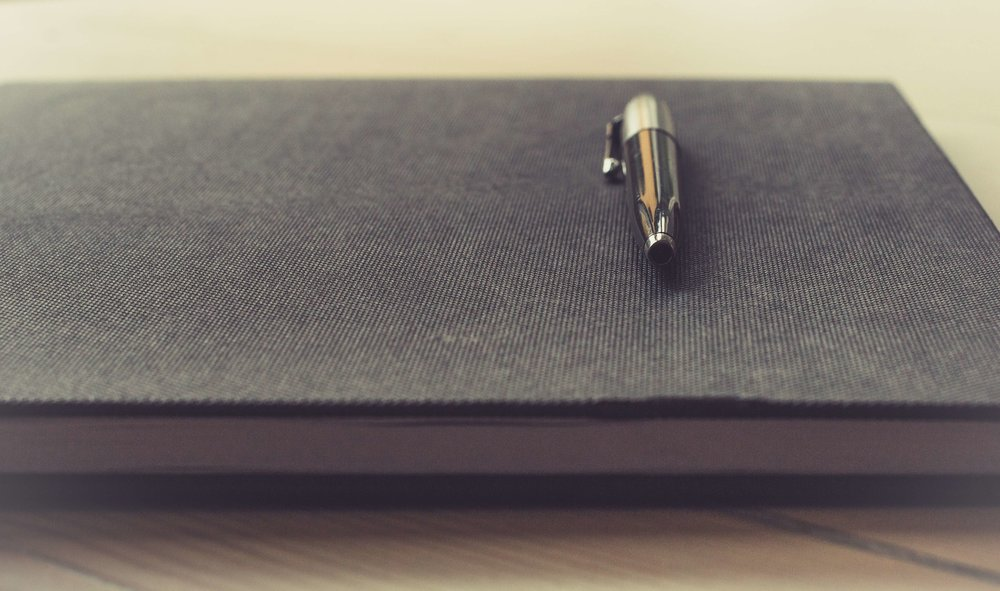 What is on the agenda for an initial meeting? Pen sitting on agenda