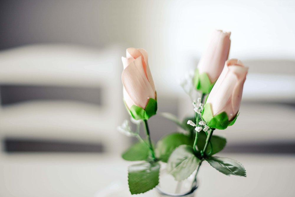Closeup of blush colour mini rose bud vase for wedding - simple elopement decor