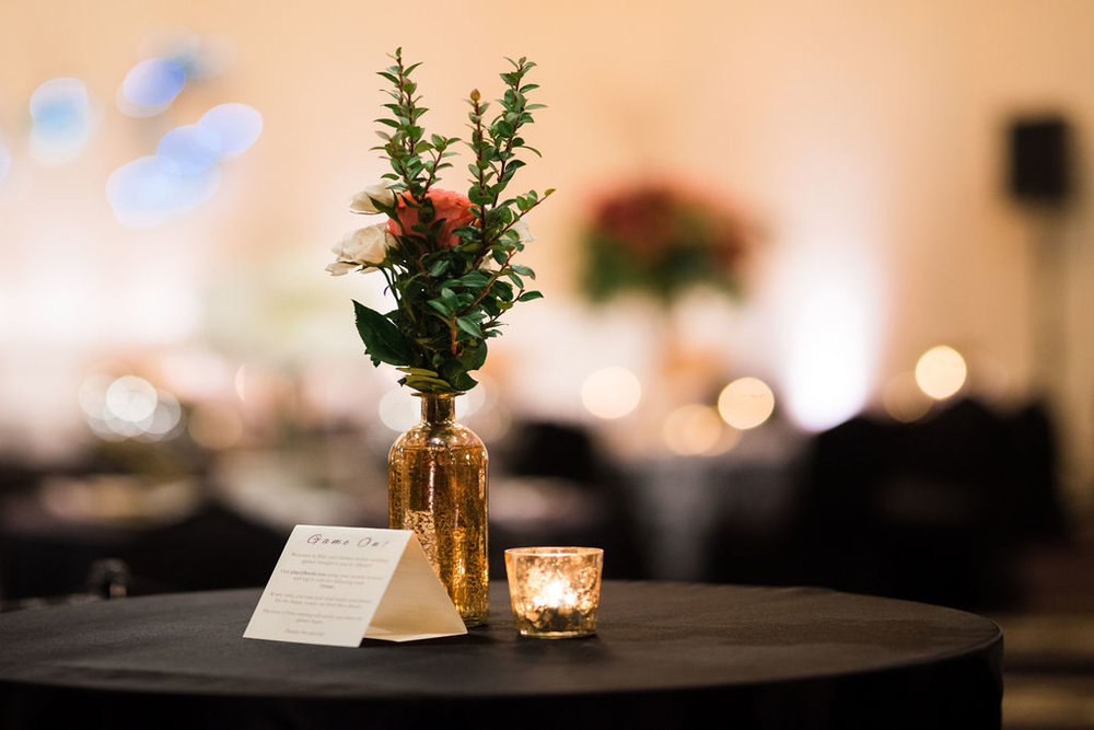 Cocktail reception wedding with bud vase on cocktail table