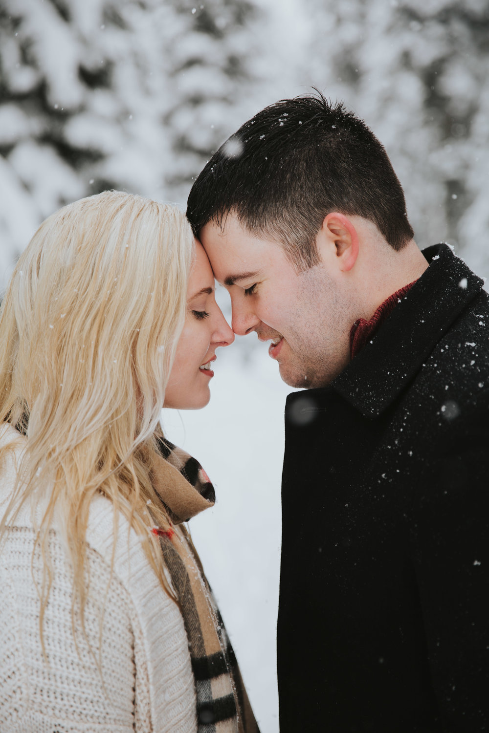 Maddie and Connor   - This couple wanted a snowy engagement shoot. I honestly had never shot at Snoqualmie before this shoot, but went up the weekend prior to scope out some locations. The day ended up being a total snowstorm, getting about 4 inches in a few hours, but the brightness and airy clean light it created made me obsessed. I love this photo because of their energy and the depth. They were so natural with each other and me and the snow added so much depth to every picture.