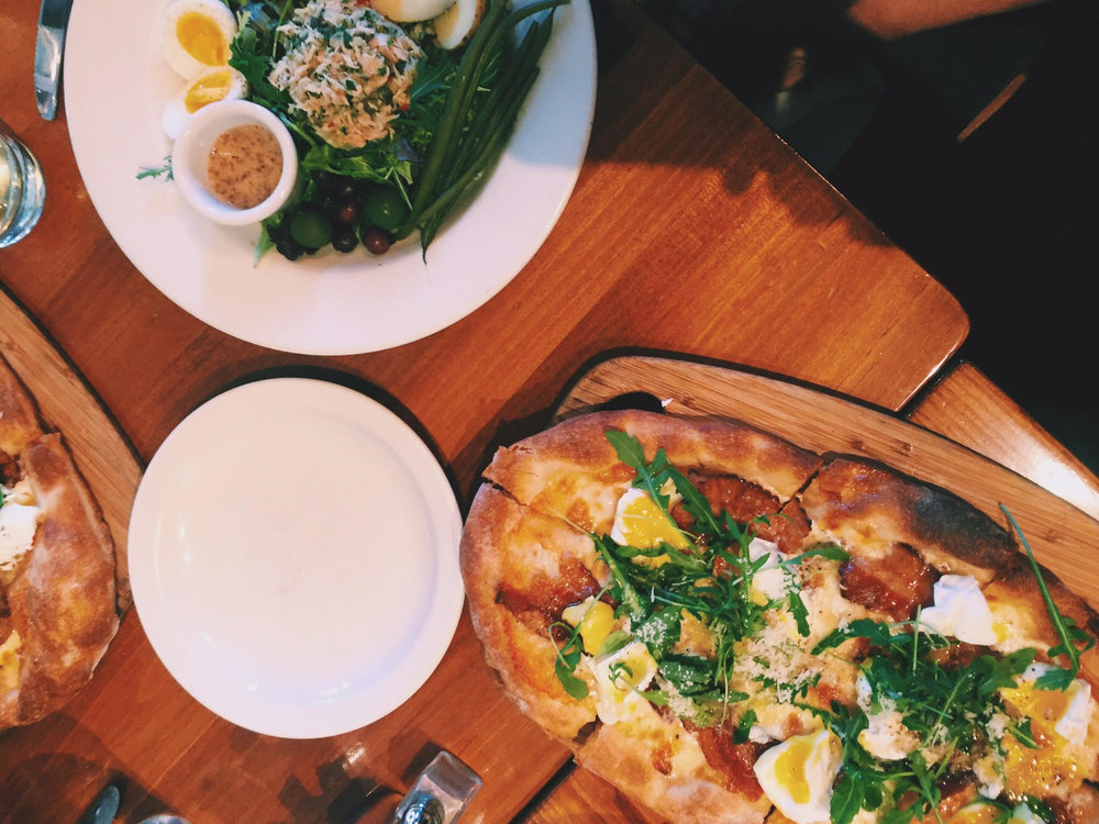 Poached Free-Range Egg & Bacon Pizza with Arugula. Photo c/o Claire D.