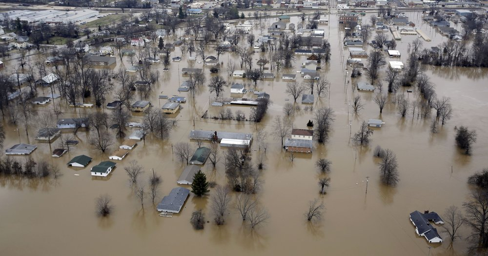 A rare winter flood in Missouri prompting many evacuations.  Photo: Jeff Roberson, AP