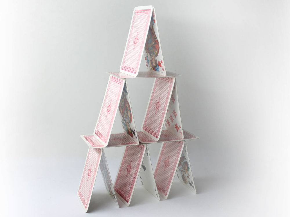 2, 5, 8... The number of cards needed for each of first three levels (rows) of the House of Cards. Photo WikiHow