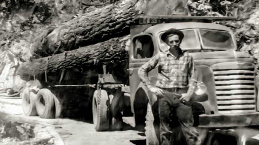 JAY HOLT WITH HIS FIRST LOG TRUCK