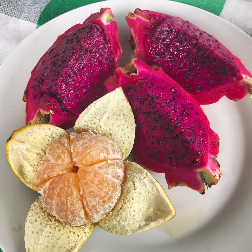 Fresh orange and dragonfruit for breakfast.