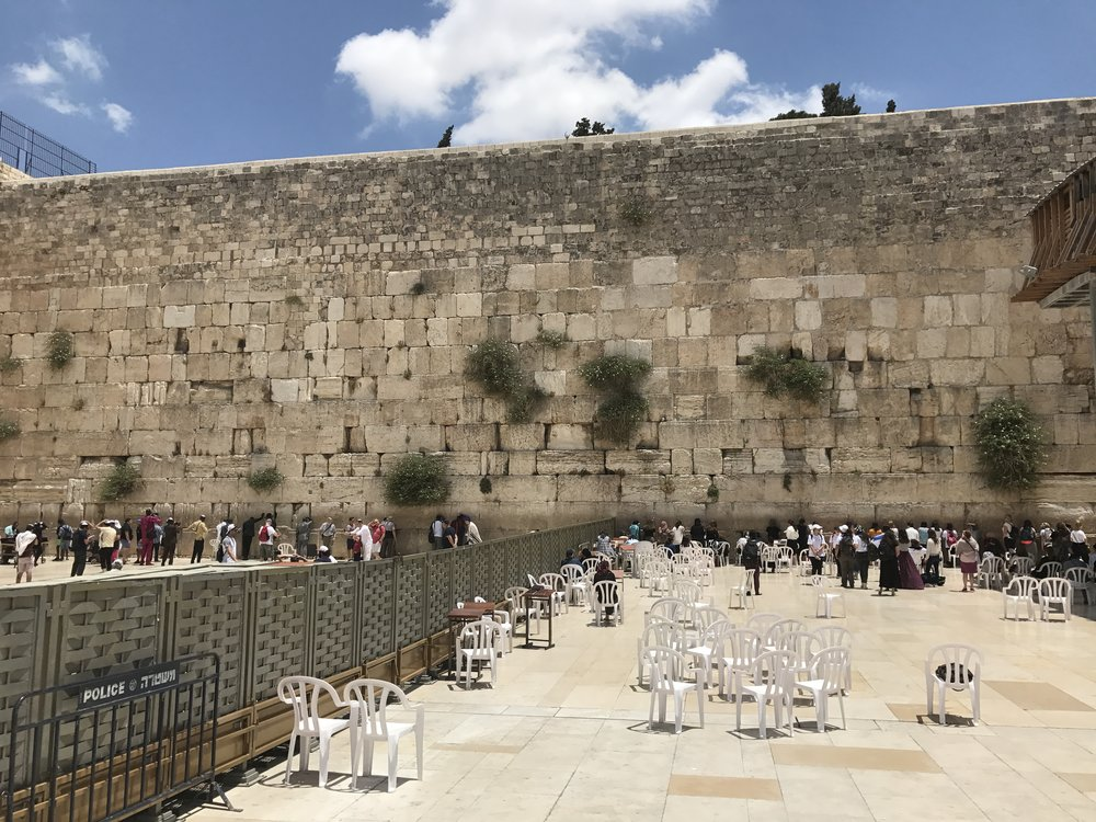 A fence divides the male and female areas of worship at the Western Wall