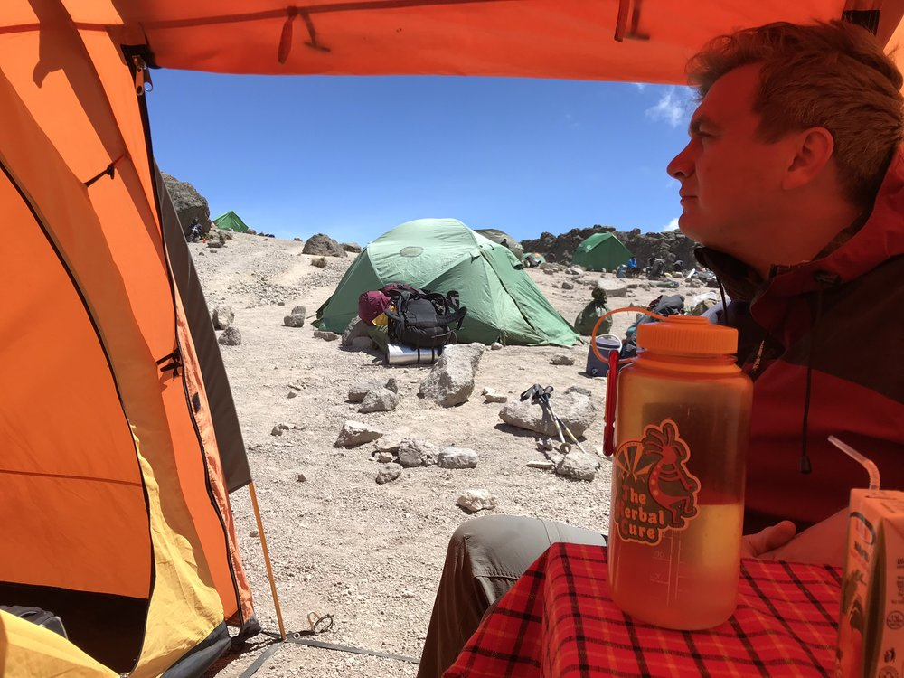 A view of the green cook tent from inside the dining area in our tent.