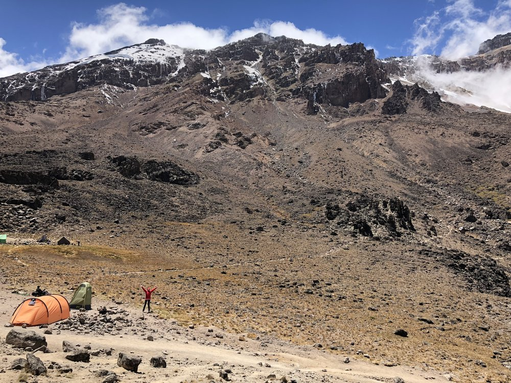 Me, really small next to our tent on our lunch break at the Lava Tower 15,190ft (4,630m).