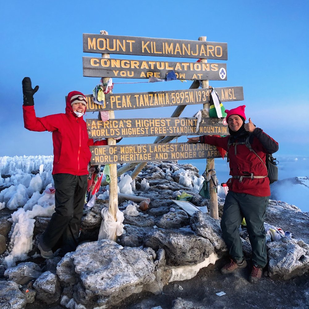 Me and Joel in front of the iconic Mt Kilimanjaro summit sign at Uhuru Peak, 6:20am, 19,341 ft / 5,895m.