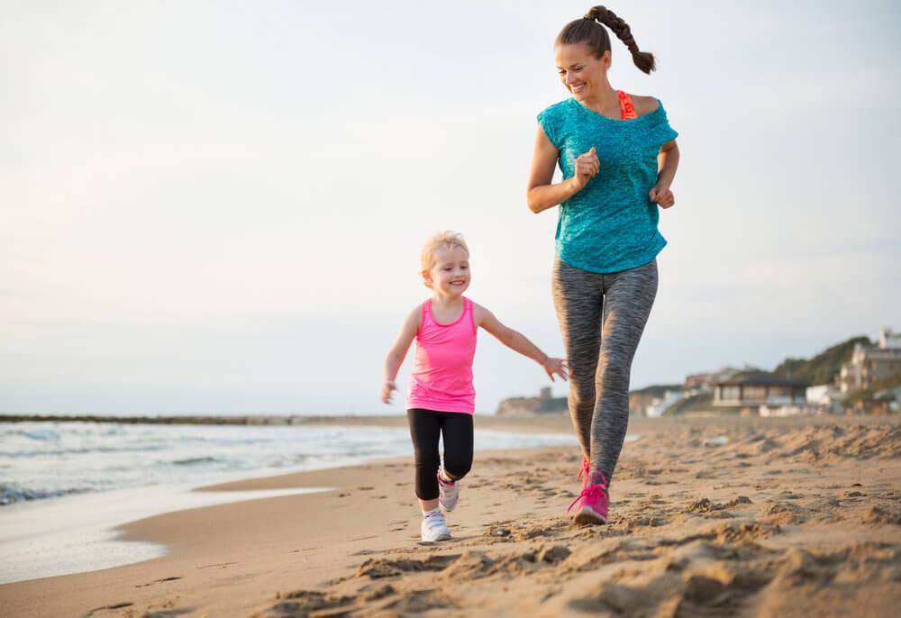 mother-daughter-running-beach.jpg