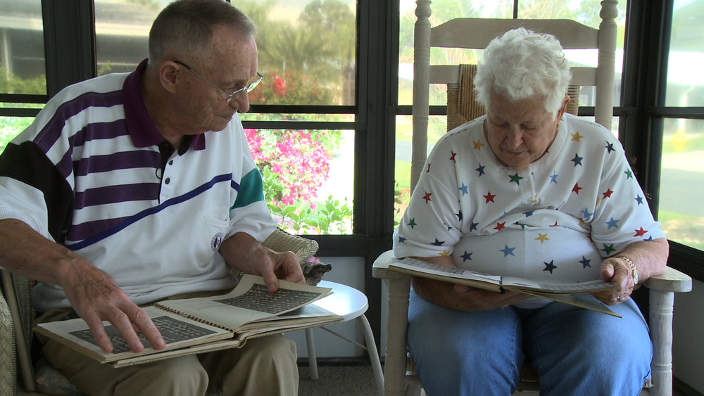 Merle and Betty reminisce over old high school year books at Betty's home in Naples, Florida.