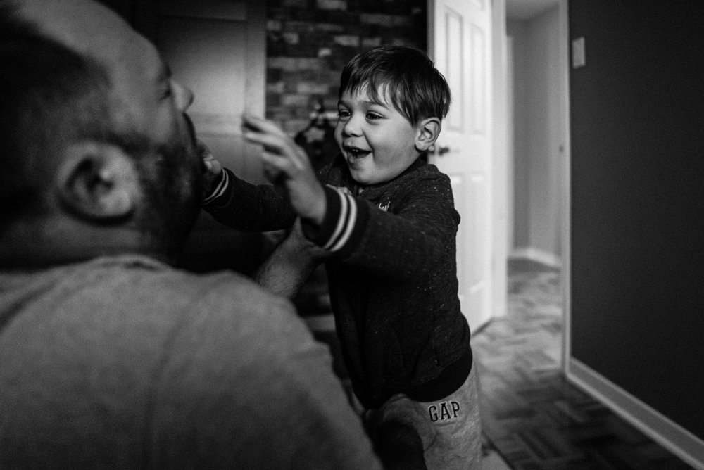 boy approaches dad with a big smile