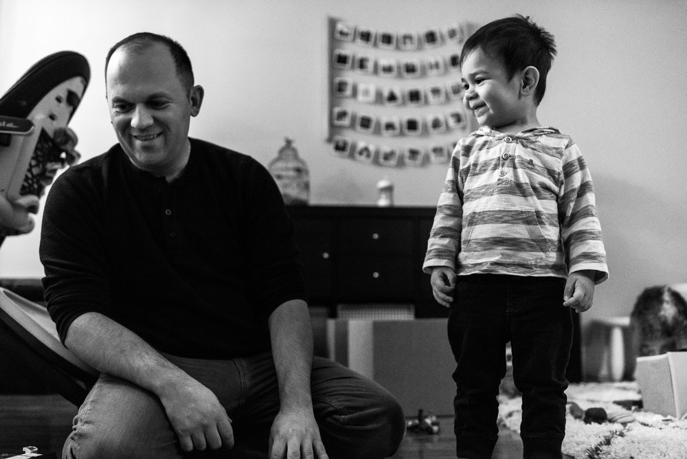 toddler smiles next to dad