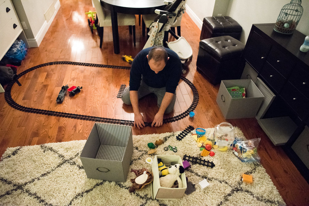 dad plays with a train set