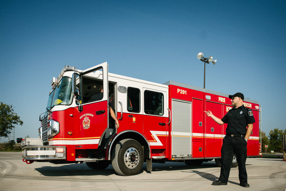 fireman stands in front of fire truck
