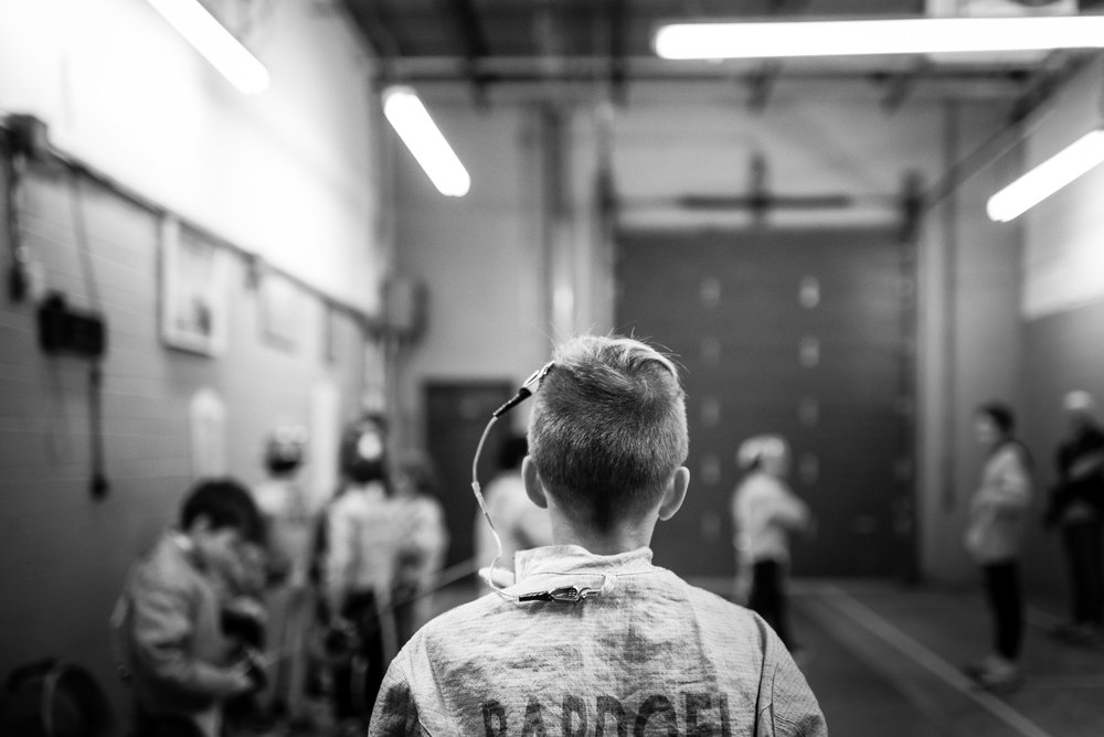 back of boy, in fencing outfit