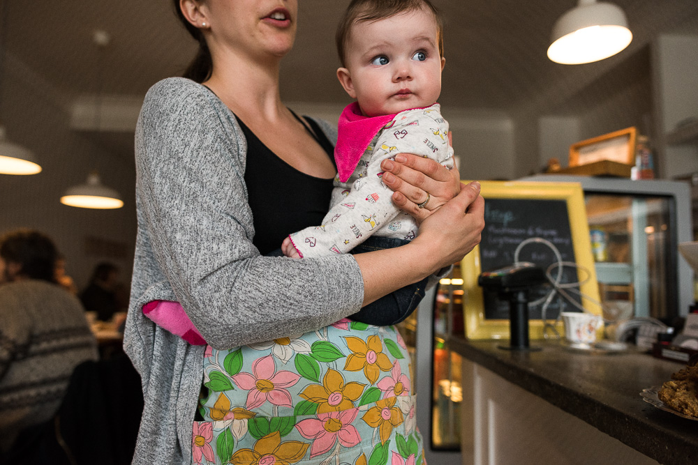 An hour in the life: Cafe-owner and new mother Logan (with baby